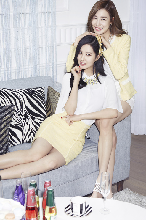 Tags: K-Pop, Girls' Generation, Seohyun, Stephanie Young Hwang, Two Girls, Yellow Skirt, Hand On Head, Yellow Headwear, Skirt, Duo, Cup, Eyes Half Closed