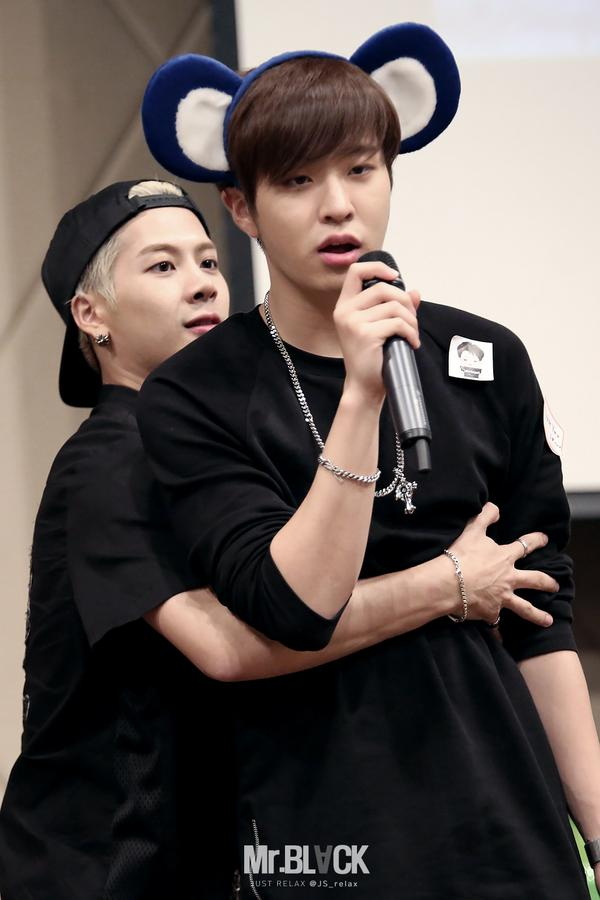 Tags: K-Pop, Got7, Choi Youngjae, Jackson, Two Males, Blonde Hair, Hug From Behind, Duo, Hug, Short Sleeves, Necklace, Black Shirt