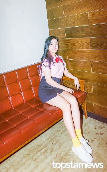 Tags: K-Pop, Berry Good, Gowoon, Multi-colored Hair, Ribbon, Short Sleeves, Couch, Highlights, Skirt, Pink Shirt, Sitting On Couch, Black Skirt