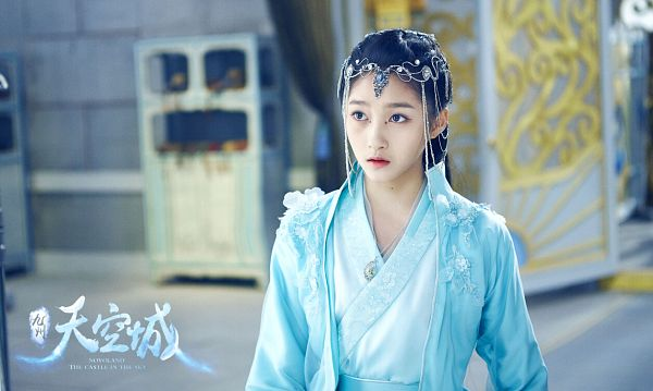 Tags: C-Drama, Guan Xiaotong, Chinese Text, Chinese Clothes, Looking Ahead, Blue Dress, Text: Series Name, Blue Outfit, Hair Ornament, Traditional Clothes, Novoland: The Castle in the Sky