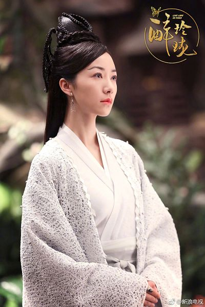 Tags: C-Drama, Han Xue, White Dress, Looking Ahead, Logo, Text, Text: Series Name, Traditional Clothes, Earrings, Hair Ornament, White Outfit, Dress