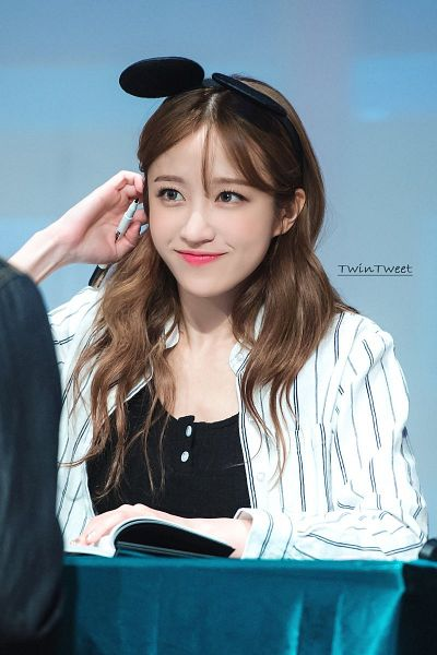 Tags: K-Pop, EXID, Hani, Looking Away, Striped, Black Shirt, Looking Up, Gray Background, Striped Shirt, Animal Ears, Hand In Hair, Pen