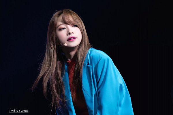 Tags: K-Pop, EXID, Hani, Dark Background, Looking Away, Black Background, Blue Outerwear, Blue Jacket, Orange Shirt, Twintweet