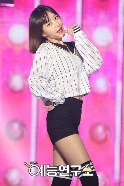Tags: Television Show, K-Pop, EXID, Hani, Shorts, Finger To Lips, Black Shorts, Medium Hair, Pink Background, Knee Socks, Hand On Hip, Korean Text