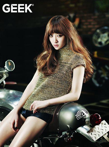 Tags: K-Pop, EXID, Hani, Text: Magazine Name, Leaning Back, Black Shorts, Dark Background, Leather Shorts, Shorts, Black Background, Motorcycle, Bare Legs