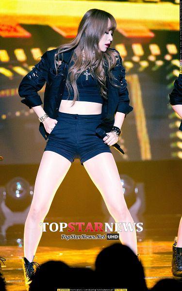 Tags: K-Pop, EXID, Hani, Black Shorts, Black Jacket, Shorts, Eyes Closed, Bare Legs, Necklace, Shoes, Orange Background, Bracelet