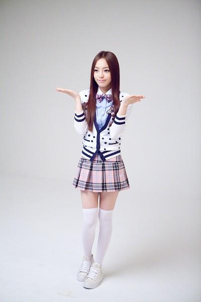 Tags: K-Pop, KARA, Hara Goo, Socks, Pleated Skirt, Gray Background, Spotted Shirt, Bow Tie, Checkered Skirt, Checkered Bow, Blue Shirt, Thigh Highs