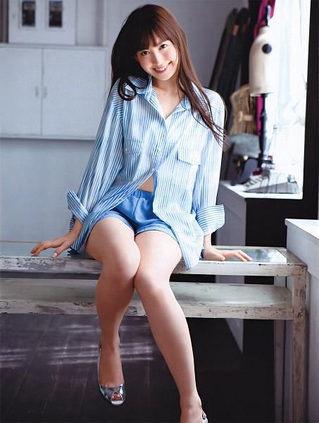 Tags: J-Pop, AKB48, Haruna Kojima, Striped, Laughing, Sitting On Table, Shorts, Silver Footwear, Blue Shirt, Table, Bare Legs, Striped Shirt