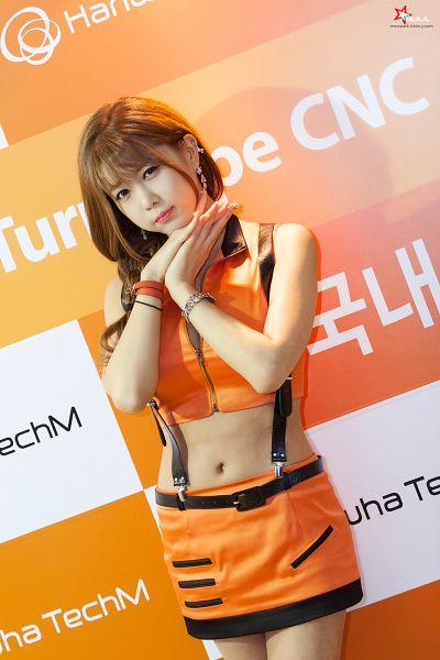 Tags: K-Pop, Berry Chu, Heo Yun-mi, Blunt Bangs, Bare Shoulders, Skirt, Hand On Cheek, Orange Outfit, Orange Skirt, Ponytail, Hand On Head, Midriff