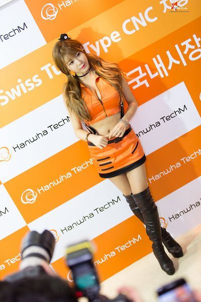 Tags: K-Pop, Berry Chu, Heo Yun-mi, Sleeveless Shirt, Looking Away, Black Footwear, Boots, Cleavage, Hair Ornament, Sleeveless, Orange Outfit, Suggestive