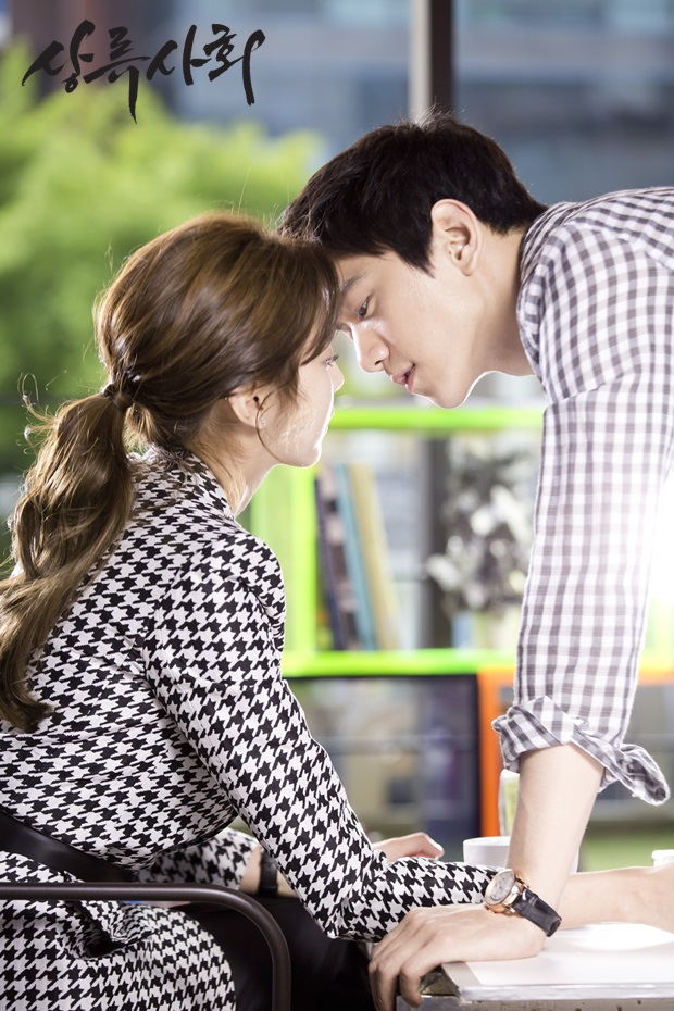 Tags: K-Drama, K-Pop, After School, Uee, Sung Joon, Wristwatch, Table, Korean Text, Hair Up, Checkered Shirt, Duo, Text: Series Name