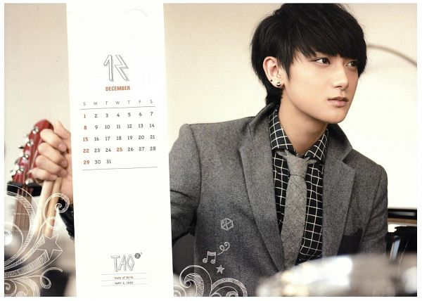 Tags: K-Pop, EXO, Huang Zi Tao, Text: Calendar Date, Gray Jacket, Gray Outerwear, Looking Ahead, Tie, Text: Artist Name, Music Note, Gray Neckwear, Brown Background