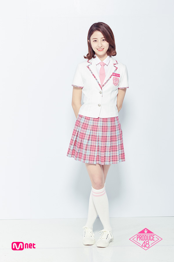 Tags: Television Show, K-Pop, Huh Yunjin, Thigh Highs, White Footwear, Text: Series Name, Short Sleeves, Tie, White Jacket, Crossed Legs (Standing), White Outerwear, Skirt
