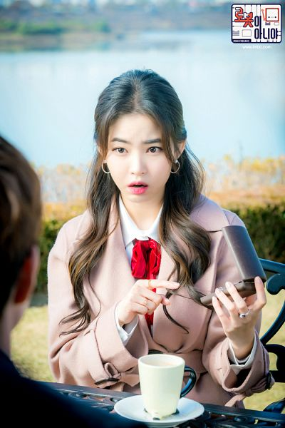 Tags: K-Drama, Hwang Seung-eon, Water, Chair, River, Korean Text, Table, Text: Series Name, Ring, Sitting On Chair, Cup, Coat