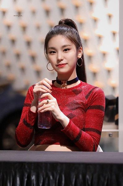 Tags: K-Pop, Itzy, Hwang Yeji, Bent Knees, Chair, Bottle, Hair Up, Red Shirt, Ponytail, Sitting, Midriff, Sitting On Chair