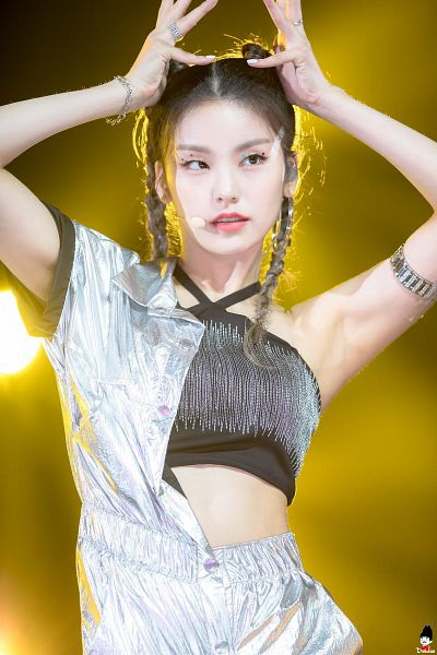 Tags: Itzy, Hwang Yeji, Yellow Background, Microphone, Braids, Hair Up, Bracelet, Black Shirt, Ring, Hair Buns, Looking Away, Gray Outfit