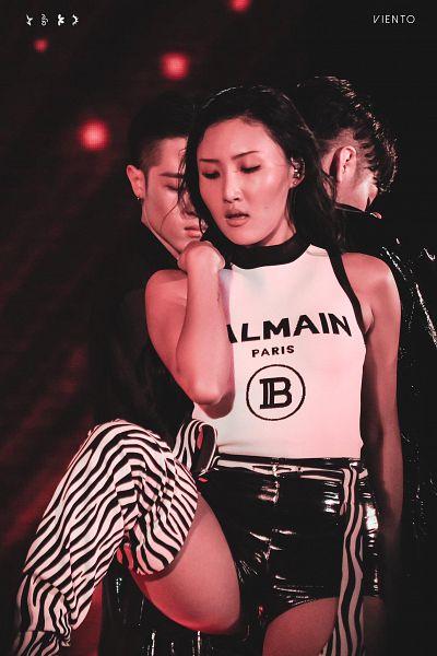Tags: K-Pop, Mamamoo, Hwasa, Eyes Half Closed, Thigh Boots, Bare Shoulders, Dark Background, Leg Up, Sleeveless, Standing On One Leg, Looking Down, Striped Legwear