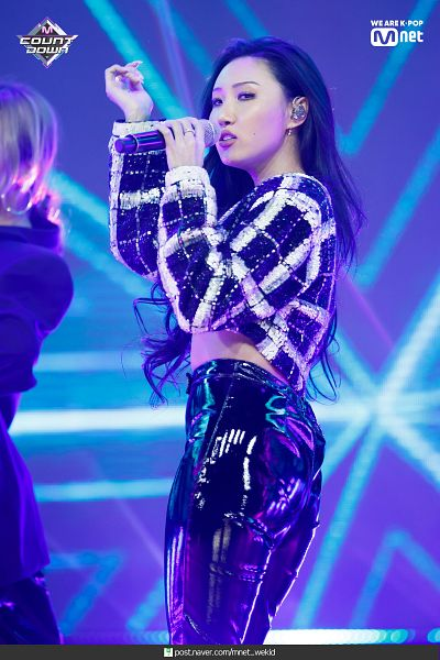 Tags: Television Show, K-Pop, Mamamoo, Hwasa, Leather Pants, Midriff, Checkered, Black Pants, Checkered Shirt, Looking Away, Blue Background, Mnet