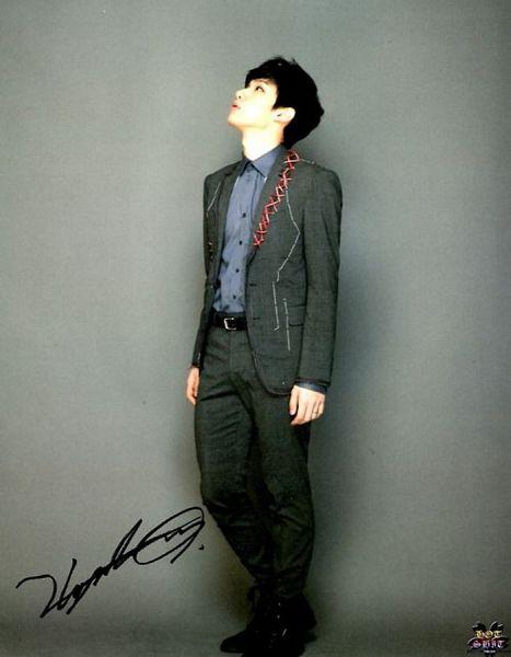 Tags: K-Pop, VIXX, Hyuk, Gray Outerwear, Gray Background, Belt, Gray Pants, Blue Shirt, Gray Jacket, Black Footwear, Signature, Looking Up