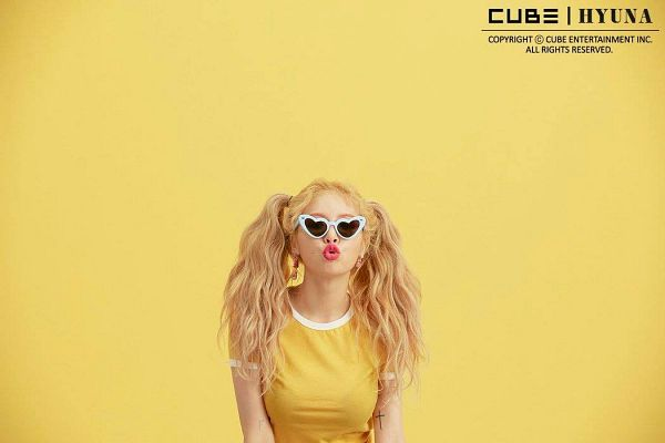 Tags: Cube Entertainment, K-Pop, Lip & Hip, Hyuna, Text: Company Name, Glasses, Pouting, Yellow Background, Sunglasses, Text: Artist Name, English Text, Wavy Hair