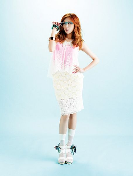 Tags: K-Pop, 4Minute, Hyuna, Red Hair, White Legwear, Bracelet, White Skirt, Pink Shirt, Glasses, Blue Background, Hand On Hip, White Footwear