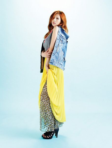 Tags: K-Pop, 4Minute, Hyuna, Leopard Print, Gray Shirt, Red Hair, Denim Jacket, Blue Background, High Heels, Yellow Skirt, Skirt, Hand On Arm