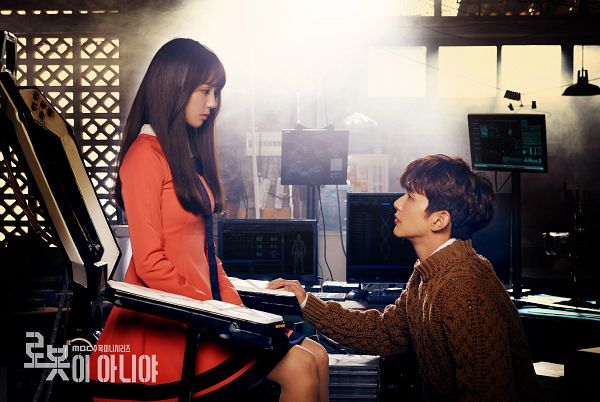 Tags: K-Drama, Chae Soo-bin, Yoo Seung-ho, Pink Outfit, Chair, Brown Shirt, Duo, Sweater, Looking At Another, Text: Series Name, Crouching, Side View