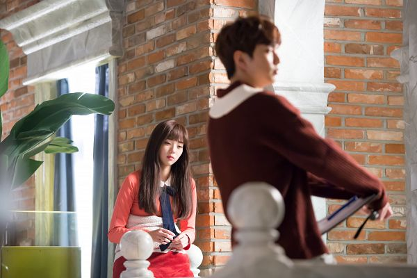 Tags: K-Drama, Chae Soo-bin, Yoo Seung-ho, Sweater, Pink Dress, Pink Outfit, Serious, Duo, Plant, Bent Knees, Looking Ahead, Sitting