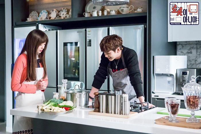 Tags: K-Drama, Yoo Seung-ho, Chae Soo-bin, Pink Dress, Text: Series Name, Pink Outfit, Vegetables, Duo, Fridge, Apron, Black Shirt, Kitchen
