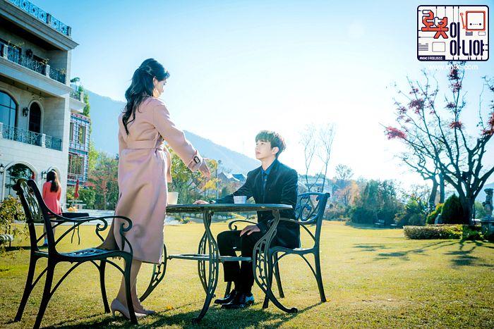 Tags: K-Drama, Hwang Seung-eon, Chae Soo-bin, Yoo Seung-ho, Korean Text, Sitting On Chair, Grass, Pink Outfit, High Heels, House, Blue Shirt, Pink Dress
