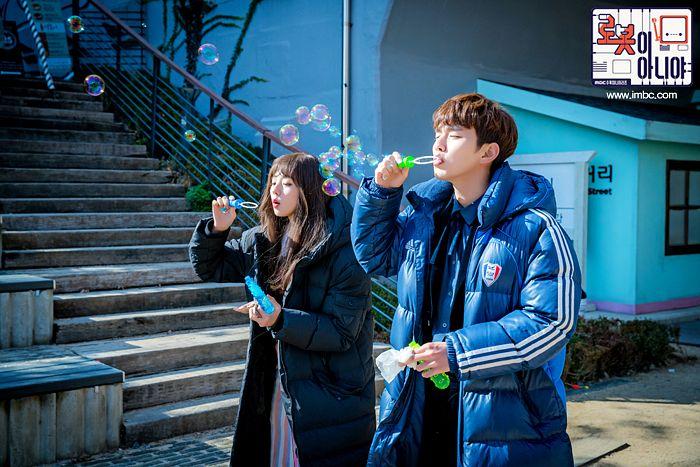 Tags: K-Drama, Yoo Seung-ho, Chae Soo-bin, Duo, Coat, Stairs, Bubbles, Text: Series Name, Korean Text, I'm Not a Robot