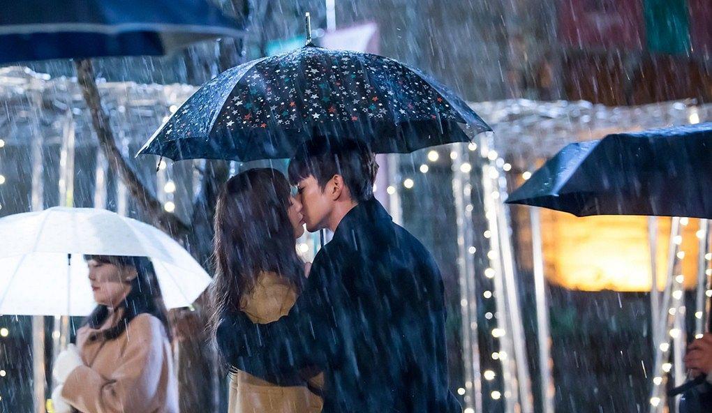Tags: K-Drama, Chae Soo-bin, Yoo Seung-ho, Eyes Closed, Black Outerwear, Water, Hug, Rain, Holding Close, Umbrella, Kiss, Duo