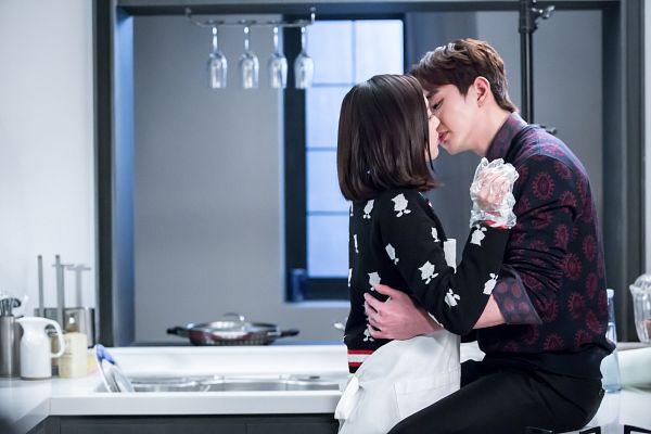 Tags: K-Drama, Chae Soo-bin, Yoo Seung-ho, Medium Hair, Almost Kiss, Sweater, Eyes Closed, Sink, Holding Close, Kitchen, Hug, Apron