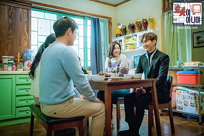 Tags: K-Drama, Chae Soo-bin, Seo Dong-won, Yoo Seung-ho, Blue Shirt, Chair, Brown Pants, Black Pants, Text: Series Name, Table, Sweater, Quartet
