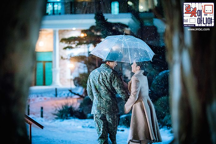 Tags: K-Drama, Chae Soo-bin, Yoo Seung-ho, Looking At Another, Plant, Uniform, Tree, Brown Outerwear, Ponytail, Night, Hat, Holding Hands
