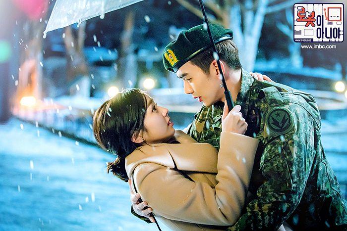 Tags: K-Drama, Yoo Seung-ho, Chae Soo-bin, Uniform, Umbrella, Text: Series Name, Medium Hair, Couple, Hat, Duo, Coat, Night