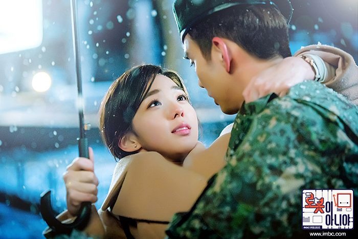 Tags: K-Drama, Chae Soo-bin, Yoo Seung-ho, Snow, Korean Text, Looking At Another, Camouflage Print, Hug, Holding Close, Ponytail, Uniform, Umbrella