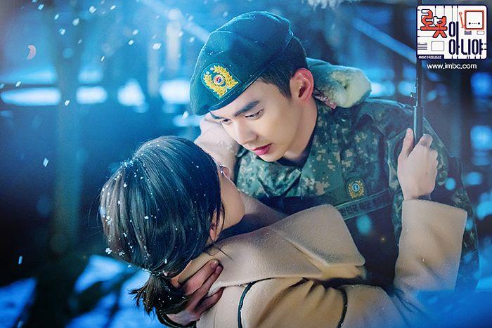 Tags: K-Drama, Chae Soo-bin, Yoo Seung-ho, Looking At Another, Camouflage Print, Hug, Holding Close, Ponytail, Uniform, Umbrella, Text: Series Name, Medium Hair