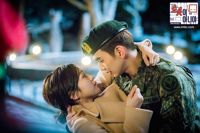 Tags: K-Drama, Chae Soo-bin, Yoo Seung-ho, Ponytail, Hat, Holding Close, Text: Series Name, Medium Hair, Couple, Duo, Coat, Serious