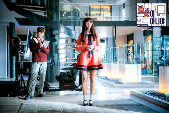 Tags: K-Drama, Yoo Seung-ho, Chae Soo-bin, Text: URL, Sweater, Korean Text, Pink Outfit, Serious, Full Body, Text: Series Name, Looking Ahead, Pink Dress