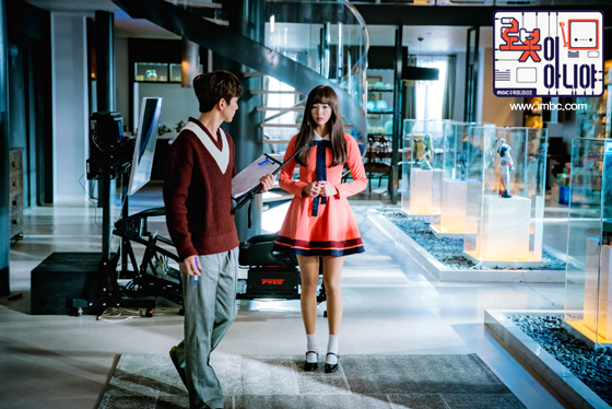 Tags: K-Drama, Chae Soo-bin, Yoo Seung-ho, Looking Down, Pink Dress, Serious, Pink Outfit, Text: Series Name, Stairs, Duo, Text: URL, Sweater