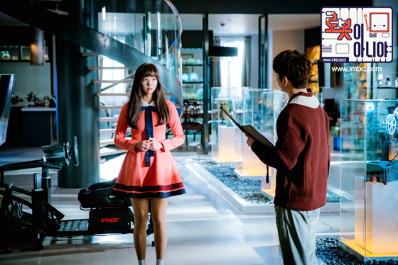 Tags: K-Drama, Chae Soo-bin, Yoo Seung-ho, Duo, Serious, Looking At Another, Text: Series Name, Sweater, Pink Dress, Text: URL, Korean Text, Pink Outfit