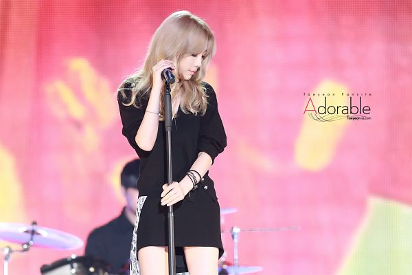 Tags: K-Pop, I (song), Kim Tae-yeon, Red Background, Looking Down, Black Jacket, Microphone, Blonde Hair, Bracelet, Black Dress, Black Outerwear, Black Outfit
