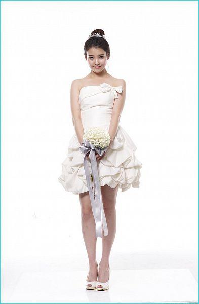Tags: K-Pop, IU, Hair Up, White Flower, Wedding Dress, Light Background, Bare Shoulders, High Heels, White Background, Bouquet, Flower, White Outfit