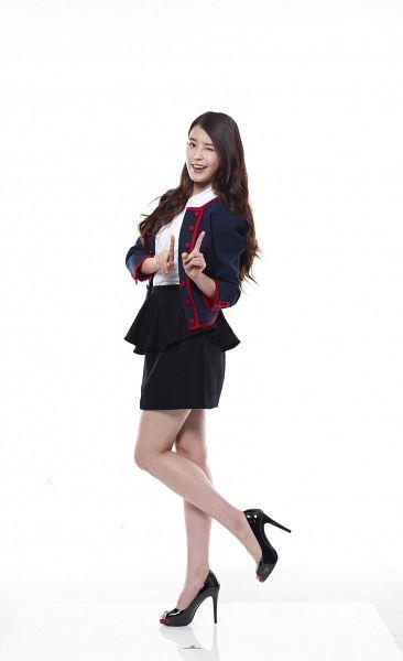 Tags: K-Pop, IU, High Heels, Leg Up, Black Skirt, Skirt, Standing On One Leg, Light Background, Blue Jacket, White Background, Blue Outerwear, Wink