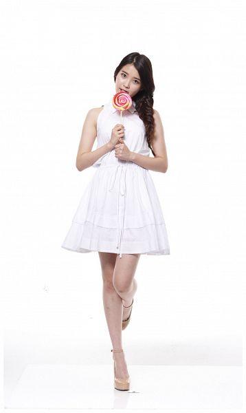 Tags: K-Pop, IU, White Background, Single Braid, White Dress, Sleeveless Dress, White Outfit, Leg Up, Sleeveless, Standing On One Leg, Lollipop, Brown Footwear