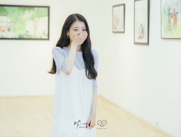 Tags: K-Pop, K-Drama, IU, Blue Shirt, Crying, Painting (action), Jewelry, Covering Mouth, White Outfit, Earrings, Standing, Dress