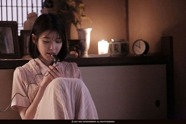 Tags: K-Pop, Through the Night, IU, Bent Knees, Dress, Singing, Sitting, White Dress, Clock, Short Hair, Fire, White Outfit