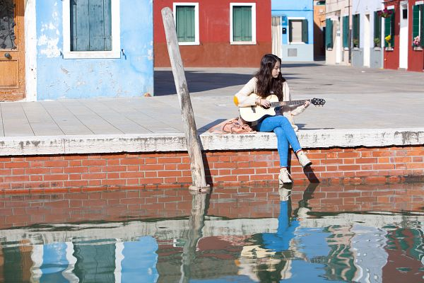 Tags: K-Pop, IU, Boots, Blue Pants, Outdoors, Wavy Hair, Water, Playing Instrument, Jeans, High Heeled Boots, High Heels, Crossed Legs