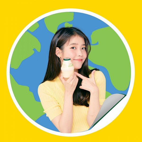 Tags: K-Pop, IU, Make Up, Korean Text, Blush (Make Up), Yellow Outfit, Short Sleeves, Drinks, Bottle, Milk, Yellow Dress, Orange Background